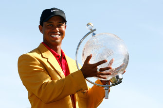 Tiger with the spoils of victory at the 2009 Australian Masters.