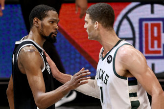 Kevin Durant and Brook Lopez share a moment after the game.