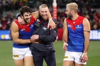 Christian Petracca, Simon Goodwin and Christian Salem celebrate a win this season.