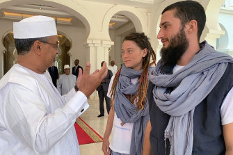 Canadian Edith Blais and Italian Luca Tacchetto, right, who were kidnapped 15-months ago in Burkina Faso, meet with UN Stabilisation Mission in Mali chief Mahamat Saleh Annadif.