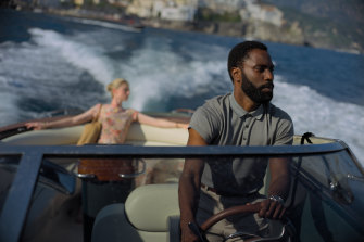 Elizabeth Debicki and John David Washington in a scene from Tenet.