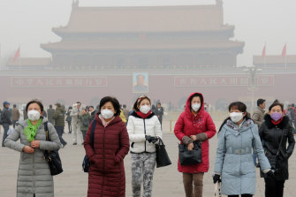 Visitors to Tiannanmen Square in Beijing wear face masks against smog, not COVID-19. With strong public demand to continue battling China's choking air pollution, some green policies also are likely to be popular at home and reduce social pressure the government sees as a threat.