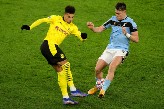 Dortmund's Jadon Sancho and Lazio's Patric in action in the 1-1 draw.