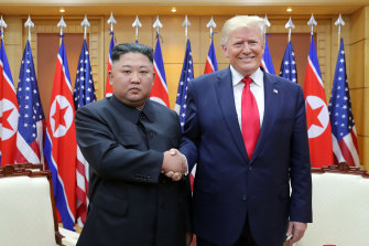 Kim Jong-un shakes hands with US President Donald Trump in June 2019. There is now intense speculation over Kim's health.