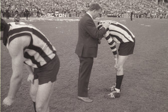 Collingwood coach Bob Rose consoles Ross 'Twiggy' Dunne after the devastating loss.  Collection: AJB