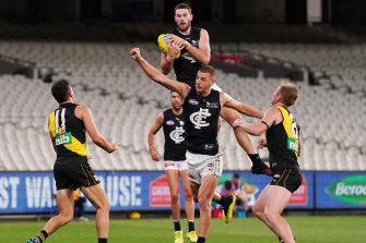 Carlton's Mitch McGovern rises high at an empty MCG.