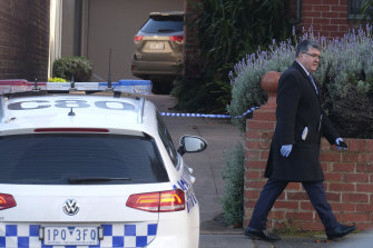 Police at the South Melbourne property where a woman's body was found.