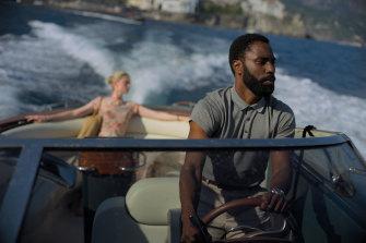 Elizabeth Debicki and John David Washington in a scene from Christopher Nolan's new sci-fi thriller Tenet.