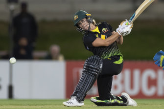 Erin Burns hits the winning runs  at North Sydney Oval on Monday night.