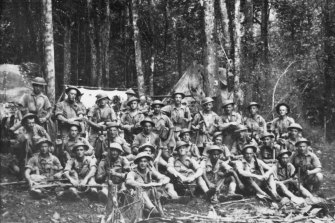 A group portrait of 9 Platoon, A Company, 2/14th Infantry Battalion on the Kokoda Trail. Harry Saundersis the  fourth from right in the front row.