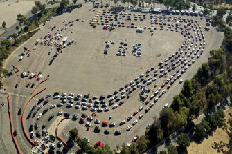 Drivers queue at a COVID-19 testing site in a parking lot at Dodger Stadium in Los Angeles this week.