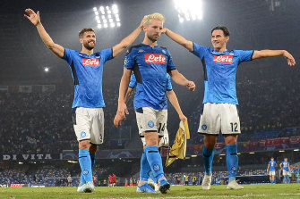 Fernando Llorente, Dries Mertens and Eljif Elmas celebrate Napoli's win.
