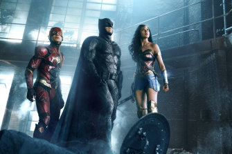 The Flash (Ezra Miller), Batman (Ben Affleck) and Wonder Woman (Gal Gadot) in a scene from Zack Snyder's Justice League.