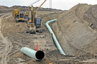 A section of the Dakota Access pipeline being buried near the town of St Anthony in Morton County, North Dakota, in 2016.