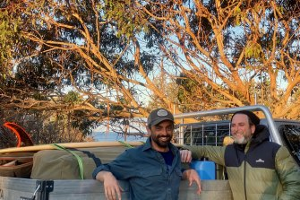 Defence barristers Adam Chernok (left) and Mark Gumbleton have swapped their robes for wetsuits and headed for the coast.