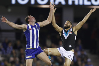 Todd Goldstein had a masterful game. Here he leaps for the ball with Port's Paddy Ryder.