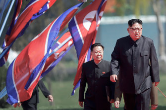 Choe Ryong-hae, vice-chairman of the central committee of the Workers' Party and No. 2, walks up a ramp behind Kim Jong-un in 2017. His son is believed to be married to Kim's sister Yo-jong.
