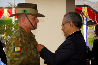 Dan Gosling receiving the Timorese Medal of Merit for service in supporting the development of the Timorese Defence Force from then president Jose Ramos Horta in 2009.