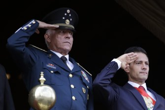 Former defence secretary General  Salvador Cienfuegos (left) and  Mexico's former president Enrique Pena Nieto, salute during the annual Independence Day military parade in Mexico City's main square.