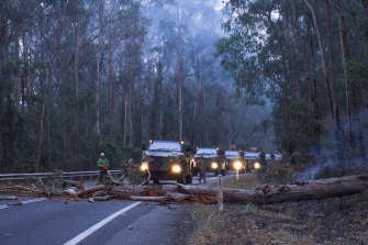An ADF operation clearing the Princes Highway, which was badly damaged by fires.