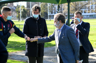 Martin Pakula fist bumps with Demon Adam Tomlinson at Monday's announcement for upgrades at Gosch's Paddock.