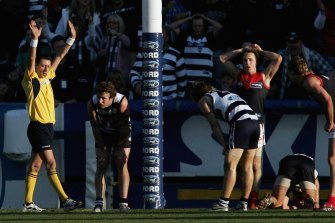 Players look shocked as the siren sounds leaving the result a draw.