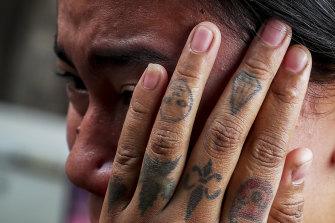 Thae Nu Naing, sister of Saw Pyae, Naing weeps by his body at their home in Mandalay, Myanmar, on Sunday.
