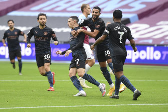 Phil Foden (third from left) is congratulated by teammates after scoring for City.