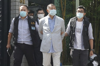 Hong Kong media tycoon Jimmy Lai, centre, after his arrest on Monday.