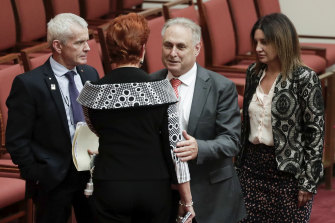 Labor's Senator Don Farrell with One Nation senators Malcolm Roberts and Pauline Hanson, and Jacqui Lambie after the Ensuring Integrity Bill was defeated.