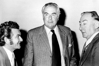 """The Prime Minister, Mr. Gough Whitlam confers with Mr. Bob Hawke, Senator Lionel Murphy in the city today."" April 17, 1974."