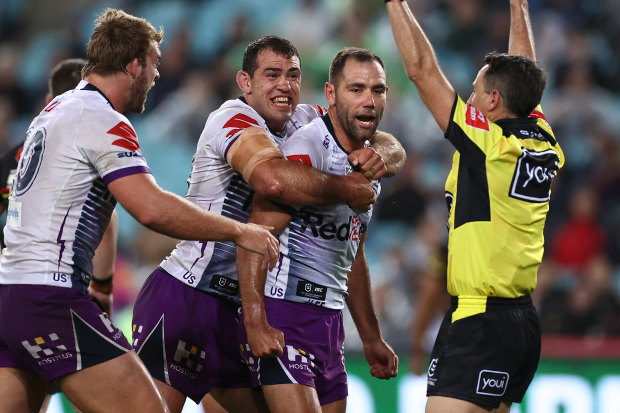 Cameron Smith celebrates during the Storm's 26-20 grand final win over Penrith.
