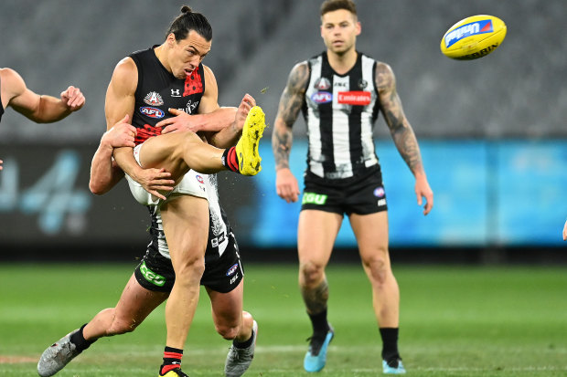 Dylan Shiel of the Bombers gets a kick away against Collingwood on Friday night.
