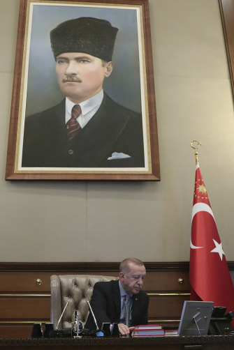 Turkey's President Erdogan, pointedly sitting under a portrait of Ataturk,  reportedly gives the orders to start the military operation on October 9.