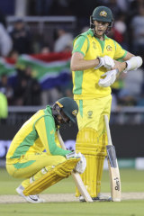 Australia's Nathan Lyon, left, and teammate Jason Behrendorff react after losing to South Africa.