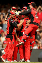 Renegades players celebrate after winning the BBL final.