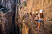 MALAGA, SPAIN - APRIL 01:  Tourists walk along the 'El Caminito del Rey' (King's Little Path) footpath on April 1, 2015 in Malaga, Spain. 'El Caminito del Rey', which was built in 1905 and winds through the Gaitanes Gorge, reopened last weekend after a safer footpath was installed above the original. The path, known as the most dangerous footpath in the world, was closed after two fatal accidents in 1999 and 2000. The restoration started in 2011 and reportedly cost 5.5 million euros.  (Photo by David Ramos/Getty Images) Getty image for Traveller. Single use only.