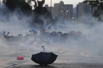 An umbrella is abandoned as protesters pull back from tear gas on Monday afternoon.