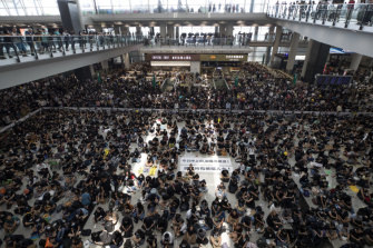 Protesters during a sit-in rally at the arrival hall of the Hong Kong International airport on Monday.