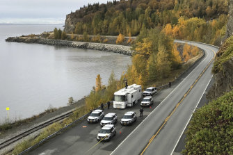 Anchorage Police pictured investigating the scene last week where human remains were found on the Seward Highway in Alaska.
