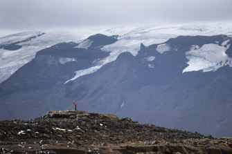 A man stops on his way to the top of what once was the Okjokull glacier in Iceland.