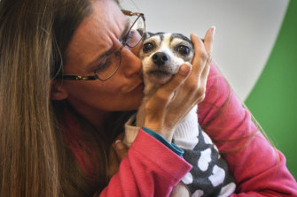 Katheryn Strang is reunited with her fox terrier, Dutchess.