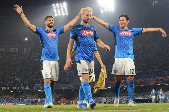 Fernando Llorente, Dries Mertens and Eljif Elmas celebrate Napoli's win.