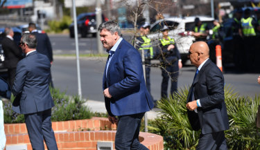 Brian Taylor arrives at Danny Frawley's funeral.