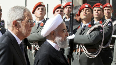 Austrian President Alexander Van Der Bellen, left, and Iranian President Hassan Rouhani attend a military welcome ceremony as part of a meeting in Vienna.