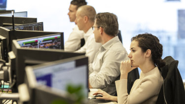 The Commonwealth Bank trading floor when the RBA announced a 0.25% rate cut.