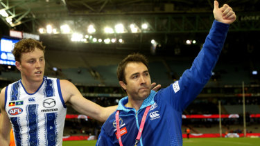 Kangaroos coach Brad Scott waves to fans after his last game as coach for North.