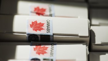 Boxes of pre-rolled joints sit stacked at a Quebec Cannabis Society (SQDC) store during a media preview event in Montreal, Quebec, Canada.