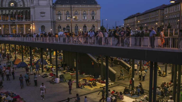 Syrian refugees camped out at Keleti station, Budapest, in 2015, waiting to travel to Germany.  The number of migrants arriving in 2018 is down to pre-crisis level.