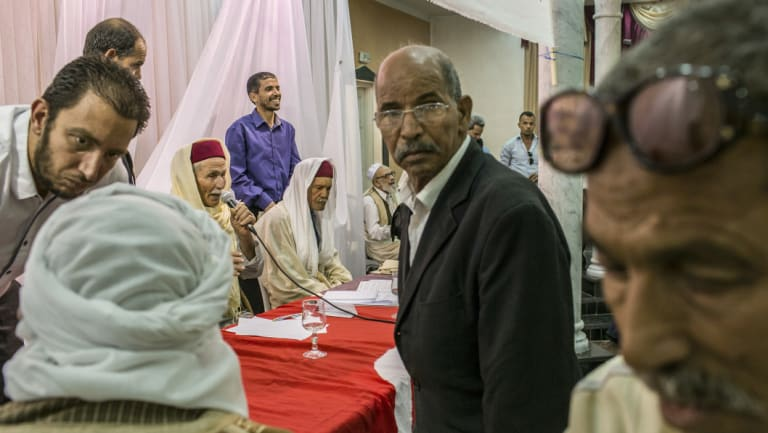 Members of Tunisia's Truth and Dignity Commission meet with  victims in Kebili, Tunisia, in 2015.